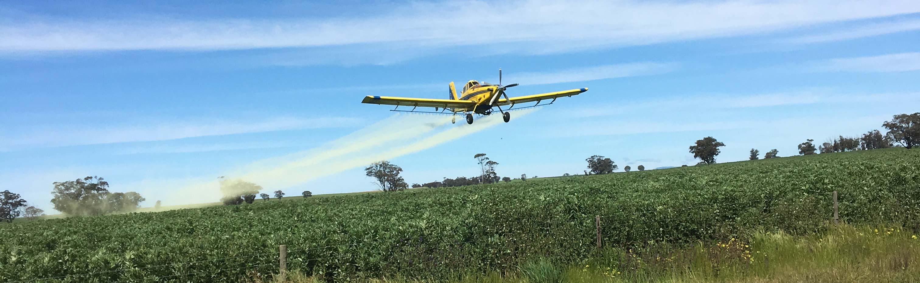 AG Airwork img of plane spraying crops